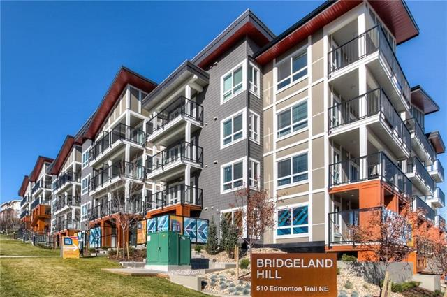 """**  Please click on """"Multimedia"""" for awesome 3D tour  **  IMMEDIATE POSSESSION IN THIS """"ALMOST BRAND NEW"""", 2 bedroom, 2 bathroom condo in very desirable Bridgeland!  At 860 sq ft this high-end condo will not disappoint!  Amazing features include: large kitchen with gas stove/soft close cabinets/under cabinet lighting, great master suite with walk-through closet and well appointed en-suite including double sinks/oversized shower, large storage room/laundry room (washer/dryer included!), big/covered/private patio/balcony, 1 titled/heated/underground parking space, 1 assigned storage locker, only attached to 2 neighbors and much more!  Building is a home run - gym/fitness facility, bicycle storage, amazing courtyard - all in brand new condition!  Location is outstanding - 5 blocks from Bow River / pathways, 2 minutes to downtown, very easy access to Memorial Drive/Deerfoot & even a green space behind the condo/building!"""