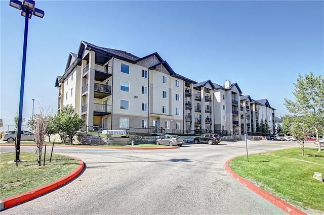HOME SWEET HOME! Welcome to your affordable investment opportunity in Mackenzie Pointe! This spacious 2 bed, 2 bath corner unit condo situated in the reputable Airdrie community of Luxstone offers a ton of value. The open concept layout boasts a bright living room, a formal dining area and a large kitchen with tasteful cabinetry and a raised eating bar. The master bedroom features 2 closets including a walk-in closet, as well as a 4 piece ensuite. A generous sized bedroom, a full 4 piece bath, laundry room and a convenient storage space complete this unit. Additional features include a titled underground/heated parking stall and a private balcony that has great views of the green space and outdoor pond. The condo fees include all utilities (electricity, heat, water/sewer etc.). This unit has lots of potential and is waiting for your special touch. Close to all major amenities including parks, shopping, schools, public transportation and quick access to Calgary! Call today.