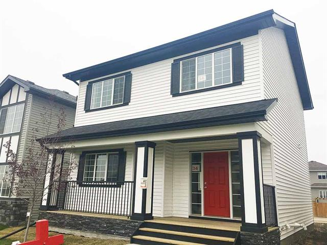 """Price Reduced now -This is it -the home is found! - w/modern finishings, extra deep lot with west backyard & great front veranda. Lifestyle Homes created an excellent design in this 1470 sq.ft.- 3 bedrooms, 2.5 bath home ,central kitchen w/island counter finished in contemporary black Honed granite, luxury soft closing cabinet doors/drawers, floating-""""quiet comfort"""" cork underlay under laminate flooring finished in """"Cappriccio""""color. Exterior flows w/interior white/soft grey cabinets & contrasting dark counters bringing bold balance & fit for any furniture & colors (especially if you make interior seasonal changes with your choice of accent colors). Large & bright foyer +9' main floor high ceiling brings more openness to spacious design. Master bedroom has an ensuite w/enlarged shower stall. Ready to move inn home (w/ New Home Warranty) -book appointment or call your favorite realtor to schedule private viewing. Relators - see members remarks."""