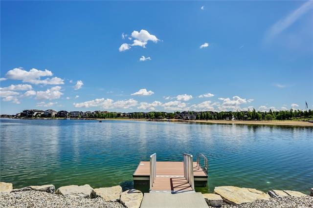 YOU CAN'T BUILD A LAKE FRONT WALKOUT for this price in South Calgary, Walking distance to SETON! ENTIRE HOME PROFESSIONALLY PAINTED THIS WEEK! Stunning, Morrison home backing onto lake with unobstructed views. 5 beds, 4 baths, WALKOUT home w/4,800 sqft of dev space. Hardwood throughout main floor, soaring vaulted ceilings w/floor to ceiling windows show off the views of lake. Chef's kitchen w/double built-in ovens, large centre island w/ breakfast bar, plenty of cabinet space and walkthrough pantry. Luxury design w/contemporary style fireplace and large dining room w/coffered ceilings. Office and large mudroom w/lockers finish off main floor. Master retreat offers his and her walk-in closets, lake views, large spa like ensuite w/Victorian Style soaker tub, dual vanities and custom shower. 3 additional beds upstairs, 4 piece bath and loft area overlooking living room. Lower level features large rec room, 4 piece bath and 5th bed. 4 mins to all levels of schools! Lake living at it's finest!