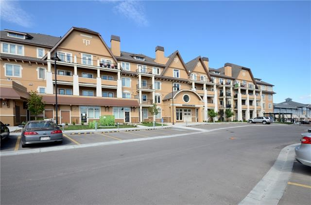 """Fantastic west facing 1 bedroom, 1 bath apartment on the 2nd floor. 9ft knockdown ceilings, Iron Ore 42""""cabinets, quartz counters, SS appliances, ceiling fan, full size washer & dryer, roughed in A/C,  in suite storage+storage unit downstairs & an oversized balcony to enjoy the westerly views! Great open floor plan including island w/space for 3 seats, room for your dining table & a cozy family room area. Bedroom is spacious & leads into walk in closet & 4 pc bathroom that can be accessed 2 ways. Tons of amenities in the building & around:Guest suites, fitness center on main level, lending library on 2nd floor, resident BBQ patio, 2 elevators, lawn area & the Urban Village w/shops & restaurants just steps away. Walk to Sobey's across the street or take a 5 mins walk to the Mahogany Lake, Beach or Parks.  A short bike ride away is 74 acres of wetlands to explore. Need a hospital? South Health Campus is a few mins drive. Easy access to Stoney Trail & QE2. If desired, some furniture may be included."""