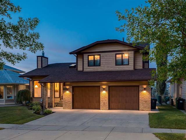 INCREDIBLE VIEWS of FISH CREEK PARK + OVER 4134 sq ft of A/C'd DEVELOPED LIVING SPACE! Located on a beautiful 566 SQ MT LOT in the SOUGHT-AFTER area of SUNDANCE, DIRECTLY Backing onto FISH CREEK PARK w/Stunning VIEWS, Steps from PARKS, PATHWAYS. O-SIZED Double Garage, HUGE Entrance w/VAULTED Ceiling + SKYLIGHT, LARGE Living rm, SPACIOUS Dining rm, Kitchen w/FAMILY-STYLE Island, TONS of CABINET SPACE, UNDER LIGHTING, MATCHING S.S. appl incl B/I OVEN + MICROWAVE, BRIGHT B-fast nook w/DECK access, MASSIVE Family rm w/FRENCH DOORS, CUSTOM Wall Units, GAS FP w/BEAUTIFUL Stone mantle, Office (converted from Bdrm), 2 pc Bath + Laundry/Mud rm. Upstairs feat 4 pc Family bath w/LINEN closet + 3 HUGE Bdrm's incl Master w/plenty of CLOSET SPACE + 5 pc En-Suite, SOAKER TUB + Shwr! Bsmt w/GIANT Rec rm incl MORE Custom B/I, Gas FP w/IMPRESSIVE brick mantle + WET BAR, 5th Bdrm w/W.I.C, 3 pc Bath, TONS of storage + NEW O-SIZED H2O! B-yard w/Deck for ENTERTAINING! DON'T FORGET: GREAT SCHOOLS + LAKE ACCESS + Whole Lot MORE!
