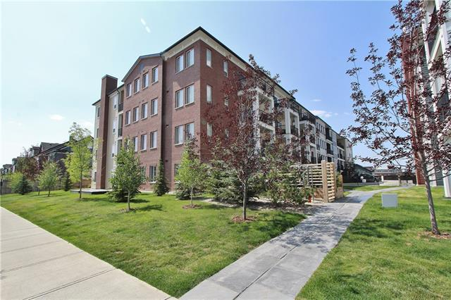 This fabulous, nearly new condo with 2 TITLED PARKING STALLS & WEST FACING PATIO onto Green Space is great for pets & located just steps to the pond & walking paths! This main floor unit features modern plank floors in the kitchen & living room with a stylish kitchen & granite counters, new glass tile back splash & stainless steel appliances...plus a custom work space complete with an upper cabinet, desktop with drawer & matching back splash. The living room is bright with large windows & has a garden door providing direct access to the private patio & green space! The Master bedroom is finished with a large walk-through closet to the 4 pc bath. This condo also features 2 ceiling fans, lots of cabinet & storage space & in-suite laundry. The exterior parking stall is right beside the front entrance...so convenient, safe & great for company! The OVERSIZED UNDERGROUND STALL has a secure storage locker as well. Great location with easy access...close to the new shops!