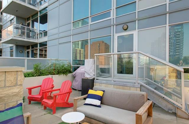 Location, layout and style fuse together in this well appointed 2 bedroom, 2 bathroom home. A wall of south & west facing windows highlights a massive 346 SqFt private patio space with an expansive view of Haultain Park. The open concept living room / dining room,with remote control window blinds, is ideal for entertaining while cooking up a storm.Efficiently designed with granite counter tops, pantry and updated appliances which include stainless steel fridge, Bosch dishwasher and Samsung twin induction stove. The master bedroom offers a walk in closet ,3 piece ensuite with a large walk in shower and black out blinds. The second bedroom features a sliding glass door with access to a 4 piece bathroom and laundry area which boasts a full size washer/dryer. Underground parking & separate storage locker. Located in the uber trendy neighborhood of Victoria Park surrounded by parks, restaurants, gym, yoga ,shopping & minutes to downtown, 17th ave and the river.