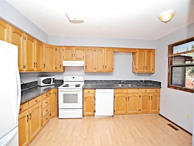 BEST VALUE ANYWHERE! Awesome, starter or revenue property, 5%-Down ($8,495), mortgage payments as low as $814/month!! Almost 1200 sq ft 2 story with a developed basement! Smart updates include a new furnace, 2 yr old hot water tank and ALL newer APPLIANCES!!! Freshly painted in neutral greys, hardwood floors in the living room with stone surround WOODBURNING FIREPLACE. The kitchen offers lovely oak cabinetry, white appliances & new countertops with sunny dining area. Two piece main guest bath has new fixtures & enjoy access from kitchen to the fenced yard with additional parking stall. New carpet throughout the upper floor with two large bedrooms up including his/her closets in the Master and south facing BALCONEY with town views and the cutest yard ever with extra parking! Four piece bath with new counters, flooring and tile surround. The basement is complete with family/media room and office with laundry room and under stairs storage. This is your chance to get into the housing market! Shows very well!!