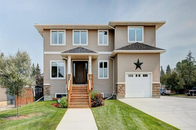 ****OPEN HOUSE SATURDAY AUGUST 25, 2018 FROM 2:00PM to 4:30PM****Beautiful 2825 Sq Ft 2-Storey on a 60 x 170 foot corner lot with oversized single attached garage and a 31ft x 24ft detached garage plus RV parking. Large country kitchen with custom full ceiling height cabinetry, extra large walk in pantry, granite counters and stainless appliances, living room has gas fireplace and 2 sliding patio doors to covered deck. Main floor has 10 foot ceilings and hardwood throughout. Also on the main is the den with built in wall safe. Upstairs is generous sized Master Bedroom with walk in closet and beautiful ensuite 2 more generous bedrooms and 4 piece bath. Basement is fully developed with 4th bedroom, family room with wood burning stove, three piece bath, laundry room and mechanical room with dedicated furnace for basement, Rinnai tankless hot water. Outside beautifully landscaped with underground irrigation sprinklers. Air Conditioned