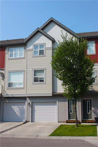 Immaculate condition! Move right into this lovely townhome. Features include new laminate flooring, wide open main floor has a good sized kitchen with centre island and stainless steel appliances and a big living room with an entrance to the west facing balcony. Upstairs are 2 large bedrooms and 2 full bathrooms. The walkout lower level is partially developed and would be a great space to work from home. All this and an attached garage too! Call today for your private viewing.