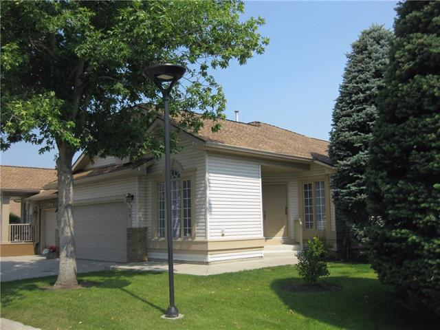 OPEN HOUSE SATURDAY NOV 17, 1 - 3PM.        This 1233 sq ft, 3 bedroom, 2 1/2 bath, double-garage, one-owner villa has been freshened-up with new paint and is spotless, just in time for you to move in. The layout is perfect for a retired couple with the main floor master bdrm and attached ensuite complete with glass shower and jetted tub. The 2 additional bedrooms and large bath on the lower level are ideal for visitors (they even have their own rec room with fireplace!). There is also a fireplace adjoining the living room & dining room on the main, and a french door out to the rear deck. The front kirchen and large breakfast nook with huge window is a cozy spot year-round, and the main floor den is ideal for a TV or computer room, or perhaps a den to just get away from it all! Affordable, adult villa living close to everything, including shopping at 130th, walking trails in Fish Creek - not to mention the golf course just around the corner.
