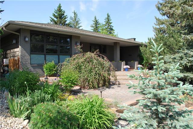 Looking for an extensively renovated LARGE bungalow in great Upper Scarboro location close to downtown, UofC, Foothills. Reno designed by Paul Lavoie, the finishing are ALL top quality.  Open inviting foyer, huge living room with wood burning fireplace, open to lovely dining area with room for 10.  Top of the line kitchen, overlooking gorgeous backyard ceiling height cabinets, granite and S/S appliances.  Family room has extensive built ins and could be 3rd bedroom.  Master suite is definitely an oasis.  Custom built ins throughout the ensuite, 2 sinks , separate shower, 2 sinks and inviting tub.Main floor laundry,central air   The yard is HUGE and so private. Perennials and shrubs throughout, lovely trees, fantastic brickwork, hot tub you would never know you are minutes to downtown!   Easy to show but alarm so some notice please.  Realtors check out your bonus!
