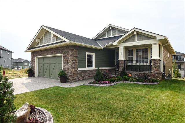 This meticulously maintained detached bungalow by original owners is perfect for the couple looking to downsize. The EXTERIOR features a durable Hardie-board siding, a double attached garage, a composite deck leading down to an exposed aggregate patio in a professionally landscaped south-facing garden with beautiful stone curbing. A water-tight shed is located underneath the deck. The INTERIOR features a water-softening system, Bee-Cool window tinting on the arched living room windows, soaring vaulted ceilings, a good-sized den / second bedroom, 2-piece main floor bathroom, granite counter-tops throughout, an abundance of storage in shaker-style kitchen cabinetry, stainless steel appliances, a large island and dining room are perfect for entertaining, a walk-in pantry, a main-floor laundry, hardwood floors, gas fireplace and luxurious thick-piled carpets. A spacious master bedroom has a large walk-in closet and 6-piece en-suite bathroom