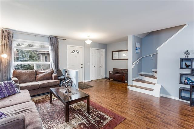 2 STOREY (Pet Friendly) WALK OUT (one of the very few listed)! Priced to sell. Nestled in off Allen Street east of Muriel Clayton Middle School. This 3 bdrm 4 bathroom row house is ideal for anyone looking for maintenance free living in a small condo community. Great curb appeal (with siding/shingles replaced in 2014/15), boasts mature trees and a sunny SOUTH facing backyard, perfect for morning coffee or evening wine. Property complete with 2 outdoor PARKING SPACES. The top floor houses all 3 bdrms and 2 full baths. Main floor offers large entry, living and a light and BRIGHT kitchen with a powder room and deck off the kitchen, making summer BBQs a breeze. The basement offers additional powder room & plenty of rec and lounging space with access to the WALK OUT DECK. Great LOCATION close to downtown, schools, nose-creek park, off-leash dog park and paths with quick & easy access to the highway. City views from the kitchen and you can even catch a glimpse of the mountains from the second floor.