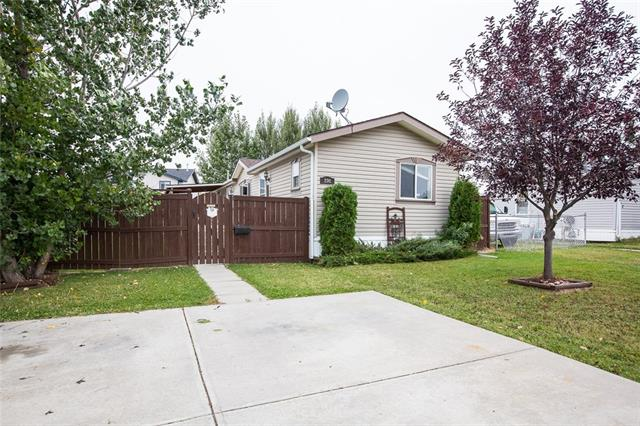 FORMER SHOW MODEL - this home has it all for a great price!  Located in a very nice and quiet neighborhood on the outskirts of Carstairs.  Enjoy peaceful evenings on your huge south facing deck (partially covered so you can BBQ in the rain), or spend time in your open concept kitchen with lot's of sunshine from the bright skylight.  Relax at the end of the day in your master en-suite with jetted tub.  New flooring and paint, the home is in great condition, a must see.  Large double concrete driveway and nicely landscaped yard with two large storage sheds for all your toys.  Don't miss your opportunity to own this beautiful home - it's priced to sell!!