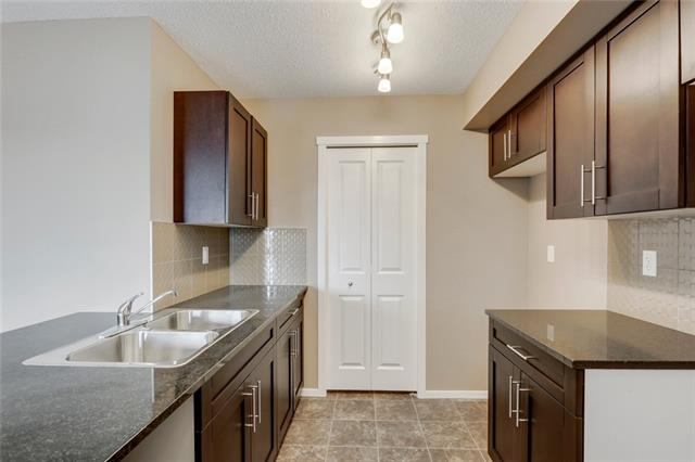 ATTENTION FIRST TIME BUYERS OR INVESTORS!! Come home to this open and bright unit. The kitchen includes granite counter tops on the eating bar and stainless steel appliances! Master bedroom features a walk through closet and a 4pc ensuite with a good sized second bedroom and bathroom. The patio has access off the kitchen and is great for entertaining or for firing up the BBQ. With stacked in suite laundry, close proximity to parks, 1 underground parking stall, and easy access to deerfoot this unit is full of value. Close to all amenities including South Health hospital and Restaurants.