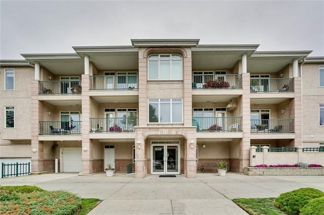 Located on the top floor, this 2 bedroom unit with 2 parking stalls has an open layout and is move in ready.  The spacious kitchen is open to the dining and living rooms and is outfitted with stainless appliances, undermount counter lighting and pantry.  The combination living and dining room space, with elegant gas fireplace, overlooks the completely private deck outfitted with a BBQ hookup.  In the spacious master bedroom, you'll find a large walk in closet and ensuite with tub and separate shower.  Rounding out the space is the 2nd bedroom, 2nd full bath and laundry room with full size washer/dryer. The space is finished with neutral plush carpeting and has A/C ready venting.  Kelvin Court, is a 40+ building that is meticulously maintained and located within walking distance to Chinook Mall, Starbucks, Shopper's, Glenmore Reservoir and a couple of minutes drive to McLeod, Deerfoot, Glenmore, Rockyview Hospital or walk across the street to the bus downtown.  This property has it all - inside and out!