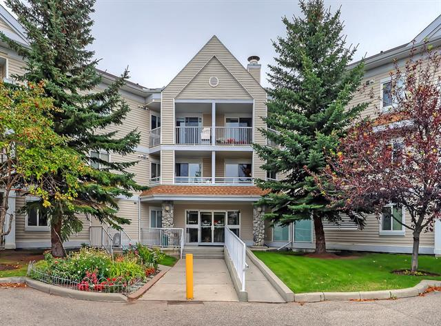 ATTRACTIVE & SPACIOUS TWO BEDROOM + DEN CONDO!  This 1,053 sqft unit has been exceptionally maintained & offers one of the most functional floor plans in the complex with spacious living areas to go along with a quiet courtyard location. The living room is adjacent to the dining area & has a bright SW patio door opening up to the patio (with BBQ gas line) & the kitchen has plenty of counter & cupboard space, a sit up breakfast counter & full appliance package. The master bedroom is very spacious & has a walk-through closet & 4-piece ensuite bathroom & the second bedroom is almost as roomy & across from the main 4-piece bathroom. The layout is completed with a very useful den/office/flex room & a good-sized laundry/storage room with enough room for a freezer. Additional features include full blinds package, laminate flooring, assigned storage locker, social & fitness rooms, titled underground parking & more! Located close to the ridge & Fish Creek pathways, shopping, schools & playgrounds. Welcome Home.