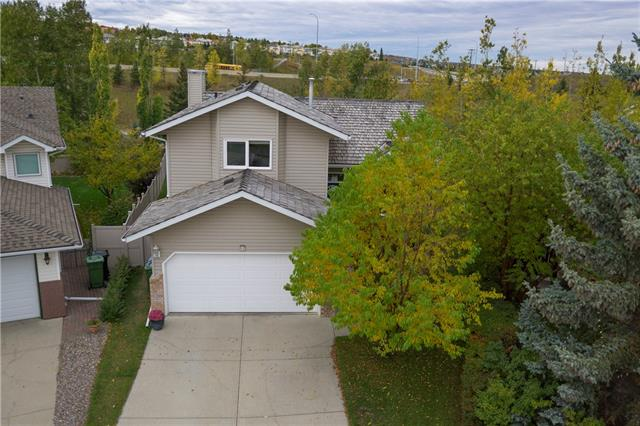 HUGE 4 LEVEL Split w/over 2229 sq ft of DEVELOPED LIVING SPACE w/WALK-OUT BSMT on a BIG 600 sq m LOT in an INCREDIBLE LOCATION!!! IN A CUL-DE-SAC, BACKING onto PARK, + CLOSE TO SCHOOL!!! DOUBLE garage, WELCOMING Entrance w/VAULTED ceilings + beautiful SLATE, Living rm w/LARGE BAY Windows, Dining rm, Kitchen w/COUNTRY Sink, GRANITE Counter tops, Matching S.S. appl incl OVER-SIZED Fridge, WINDOWS over SINK + MORE SLATE, B-fast nook w/Door to 2-tiered DECK, Family rm w/Gas FP + GORGEOUS Stone mantle w/B/I unit, Bedroom (used as office), 2 pc bath, + CONVENIENT Laundry rm. Upper level w/4 pc Main bath + 3 Bdrm's w/CROWN MOULDING incl HUGE Master w/DUAL closets + AMAZING UPDATED 5 pc En suite - Dual vanity, JETTED TUB, + STAND Up SHWR. Bsmt w/BIG Rec rm (door to B-yard), 5th Bdrm w/W.I.C. (currently used as gym area, but easily converted back), + CRAWL SPACE for ALL YOUR STORAGE NEEDS! LOVELY GIANT B-yard w/SPACIOUS 2-tiered Deck + PATIO area, TREES (incl APPLE TREE), Shrubs, + BACKS on PARK w/WALKING PATHS!!!