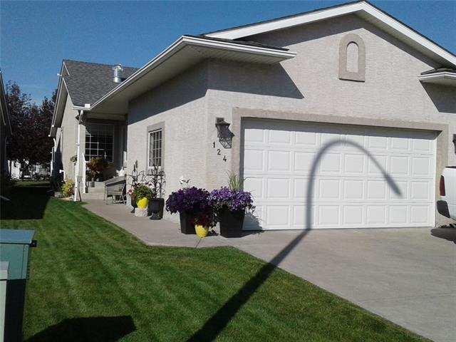 This immaculate, beautifully finished Villa on a friendly, quiet street in NW High River is waiting for your personal touch!  Main floor extras includes vaulted ceiling, large kitchen, luxury grade carpet & upgraded appliances!  You will find the master suite, den/2nd bedroom, powder room and laundry on the main floor.  Downstairs is fully finished and offers a cozy family room with a gas fireplace with a wet bar, a spacious bedroom, 4 piece bathroom with tons of storage space.  The front attached double garage is completed with drywall & painted with shelving.  The rear oversized deck views is to a private green space that adds to the quiet enjoyment of the area.  Beautiful walking paths to the river just across the street.  A must see!  Call your realtor for a viewing today!