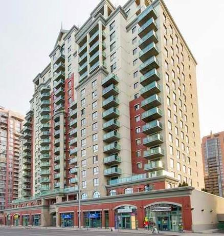 Excellent value in the West end of downtown - steps from the c-train and Bow river. This 2nd floor unit has 12 foot ceilings with huge windows and a large master. In suite laundry, black appliances, breakfast bar, and SW facing balcony. Includes titled underground parking. Building has concierge, fitness center, and bicycle storage. Low condo fees include all utilities.