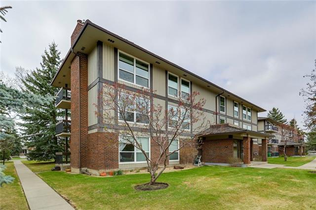 Imagine living mere steps away from serene Fish Creek Park with all its pathways meandering through nature, over creek bridges and through forested meadows listening to the birds and sighting wildlife all around! Paradise!! This top floor corner unit is the largest floorplan built in the entire development. Only one partial common wall to share. This unit was a 3 bedroom plan which was renovated making one huge master bedroom with ensuite bathroom plus an additional second bedroom. Nothing was spared in upgrading this beautiful unit. Light bleached hardwood floors. New doors, trim, lighting, bathrooms and of course a stunning Alderwood kitchen! Gleaming granite countertops & stainless steel appliances. Large dining room open to the great room featuring a cozy wood burning fireplace, re-designed wet bar & loads of large newer windows that let the light flood in! The private corner balcony is tucked away, is covered and overlooks a courtyard and into the large evergreen trees!