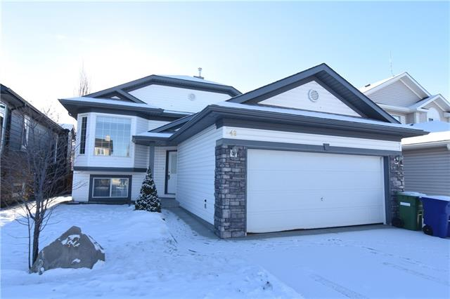 JUST REDUCED To $379,900!! Original Owner. Spacious, open Bi-Level with Soaring, Vaulted Ceilings. A total of 2,390 sq. feet Developed! Cozy Gas Fireplace in the open family room.  Carpet just professionally cleaned.  New RPR. Generous Master BR with 4 piece en-suite with Jetted Soaker tub.  Upgraded 50 gallon hot water tank. One year New Washer & Dryer in the laundry area. Half bath next to the Second upstairs BR.  Basement was Professional Developed by the builder when the home was built. Theater room, Two Bedrooms, 4 piece Bath and Utility room down. The basement has large windows that bath the basement in natural light.  Double Attached Garage 23 x 19 feet or 455 sq feet. Large raised deck off the kitchen nook that over looks the sunny, south back yard. Abundance of pathways, parks and even a pond in the community to enjoy.  The community centre has an indoor pool, gym, etc.  A quick possession is possible. Quiet Location with a tot lot just up the street which is, perfect for children.