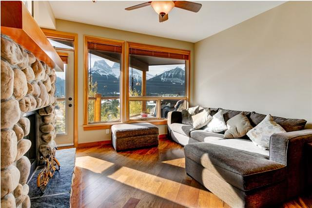 Spectacular mountain vistas across the Bow Valley are framed throughout this single level mountain home. Positioned in an enviable location in Mountain Winds condominium, this lock and leave apartment features two bedrooms, a den, two full baths, an open concept living space, laundry room, two separate storage units and two indoor parking stalls. The covered balcony can be a year-round retreat with views stretching from the Three Sisters and beyond. Stylishly appointed, this home is located in the heart of Canmore?s Eagle Terrace community. Steps to restaurants, cafes, and shops the area around Cougar Creek is a community hub. A paved path takes you to Downtown Canmore and there are countless trails to explore from your doorstep; hike up Lady Mac or ride the Montane before enjoying a glass of wine on the balcony. This private retreat offers you an ideal mountain lifestyle within a professionally managed building.