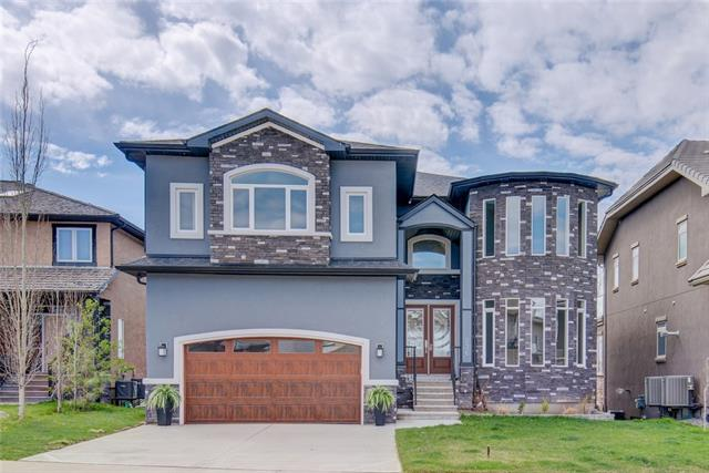 Welcome to this luxurious modern custom build which backs onto Chestermere lake. If you are looking for outstanding finishing, high-end details, and quality luxury, then this is the one for you. Backing on to the lake in Chestermere, you can watch your kids play on the beach all day long, while you cook in your executive kitchen or lounge and soak in the view on one of your SW-facing decks. More than enough space for the family and friends with over 5000sqft of developed space, including a terrific walkout basement with great wet-bar to entertain after your beach days (or the perfect space for your nanny or mother-in-law!) You will appreciate the high-end touches, like built-ins in ALL closets, warm walnut feature walls/beams, classy and high end light fixtures, top of the line appliances, and more. If you want to feel like the King & Queen, then make this your castle!