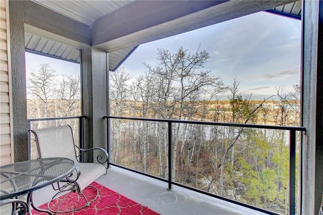 EXCEPTIONAL VIEW & VALUE in sought after Aspen! 2 bedroom 2 full bath condo. Prime location east facing unit OVERLOOKING THE TREE TOPS & THE LAKE adding to your private covered balcony oasis (w/gas hook-up). Perfect for co-owners, guests or a roommate as bedrooms & baths are on opposite sides of this home while still allowing for a light filled open concept. Both baths offer granite counter-tops & the ensuite bath has a soaker tub & separate glass shower enclosure. The open kitchen boasts newly updated countertops, sink, tile backsplash and lighting. Raised breakfast bar & stainless steel appliances. Cork and tile floors throughout. In-suite laundry w/full sized front load washer & dryer. 9' ceilings. Plenty of storage with large storage closet plus a large storage locker. HEATED PARKING with TITLED stall. 2 fitness rooms, guest suite and bike storage. Stroll to Aspen Landing for boutique shops & chic restaurants. Just minutes to Westside Rec Centre, C-train & a quick commute to downtown! Simply move in!