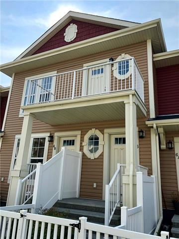 Mosaic Montage! Immaculate townhouse with exterior front entrance and attached garage! Open and spacious living room with cork flooring, access to sundeck with a view of the mountains on a clear day. Modern kitchen with mocha cabinets with granite counter tops & stainless steel appliances. Dining area with south exposure. Master bedroom with walk through bathroom with washer & dryer. Stairs down to single attached garage with storage. Pets allowed with condo board approval. Access to the beach at the Lake of Auburn Bayand close to South Health Campus and many shops, restaurants & services.
