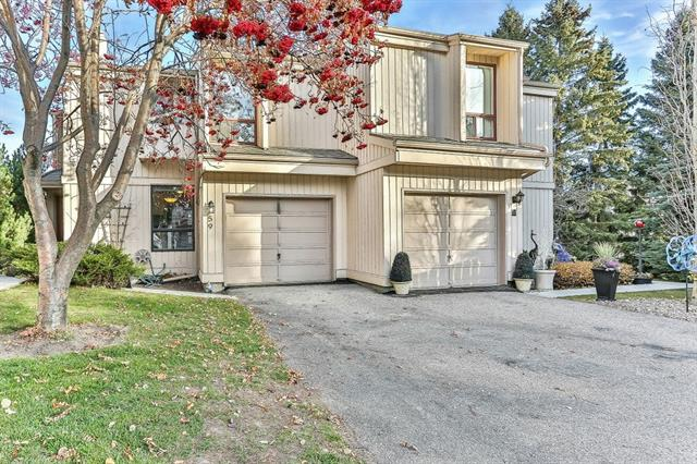 **PRICE REDUCTION**OPEN HOUSE SUNDAY-1:00-3:30PM-Backing onto a PARK like setting has never been so easy!! This 2 STORY semi-renovated FRESHLY painted open WALKOUT townhouse is a must see and checks all those boxes- MOVE IN READY. You will be impressed when you step into the beautiful WHITE kitchen with High-end STAINLESS-STEEL appliances w/gorgeous GRANITE counter tops and breakfast Island. The RENOVATED main floor bathroom is nothing short of being impressive with its stone feature. Living room boasts VAULTED ceilings, neutral laminate floors, and a cozy WOOD burning fireplace for those cold nights. Upstairs grants you a MASTER BEDROOM with built ins, a FULLY RENOVATED stunning 4-piece master en-suite, w/QUARTZ tops, 2 SINKS + designer tile. Another functional bedroom compliments the upstairs along with a LOFT. Downstairs offers a large REC room, Laundry room and patio doors to the outside. Location is superb to AMAZING shopping, restaurants and SCHOOLS, Great access to MAJOR roads.