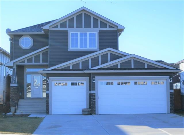 The family home you've been looking for in the progressive community of Carstairs, across from a large park area is right here waiting for YOU! Save on all of the extras that you would need to pay additional cash for in a newly constructed home such as blinds (upgraded to dual blackout/privacy honeycomb), landscaping incl trees & rose bushes and fencing. The main floor has a front den/office and open concept living area plus full 3pc bath at the garage entrance. Upstairs are 3 bedrooms plus bonus room & laundry. The ensuite includes dual sinks, separate throne room and separate bath/shower. Built in shelving in the bonus room and main living room are beautiful and functional. The back yard is big enough for all of your toys and playground equipment and includes a multi-level deck with gas for the BBQ. The piece de resistance is the triple attached garage that will fit any pickup in your fleet with bump-out work space too. Come and find out what this great home and community can offer you and your family!