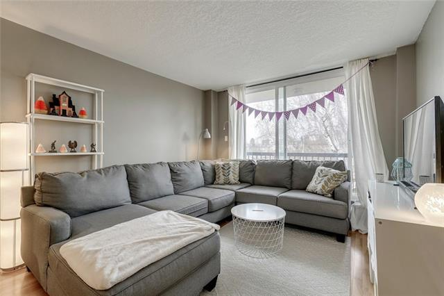 **Attention Investors! Was Rented for $1,200 until April 2018**  Why pay rent when you can own this cozy unit in the heart of one of the trendiest districts in Calgary? Cameron Heights is a quiet, concrete building located steps away from Calgary's most iconic street - 17th avenue.  The location is unbeatable, just steps away from the restaurants, shopping and cafe's of 17th Avenue and a short walk to the Downtown Core and Transit. This sleek, stylish, open plan 1 bed/1 bath unit with low condo fees is sure to impress! Large windows in the living room allow a flood of natural light into the unit.  Walk out onto the balcony to enjoy your Downtown view. Lots of storage in the open-concept kitchen, complete with functional raised breakfast bar. This unit comes with one parking stall and a storage locker!  Low entry price and condo fees mean lots of revenue potential for investors. Perfect for someone that wants to be within walking distance to everything.