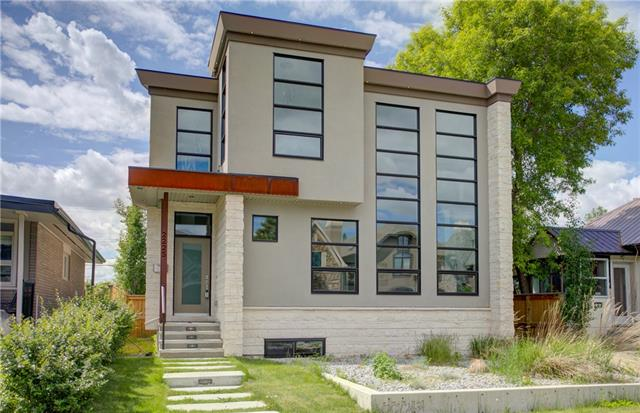 """Please click """"Multimedia"""" for 3D tour! Stunning, fully developed 2 storey work of art in VERY desirable West Hillhurst! This executive home features: chef's kitchen with gas stove/wine fridge/butler pantry/pot-filler faucet, amazing curved staircase, built-ins throughout, 3+1 good sized bedrooms, towering 2 storey feature wall/bank of windows, theater room, beautiful wine display, oversized/insulated double garage, 2 staircases to walkout basement, deck & lower patio, staircase to future rooftop patio, A/C, custom lighting package second to none, chic master suite with air massage tub/large shower with chic """"tile-top linear drain""""/large walk-in closet, Smart Home system, TRIPLE pane windows, 2-zone in-floor/in-slab heat in basement & MUCH more! Location is perfect - backing onto Broadview Park, views of Bow River & DT, 10 min walk to DT & Kensington, 2 blocks from Bow River Pathway & very easy access to Crowchild & Memorial Drive. This 2014 SAM Award winner will not disappoint!  IMMEDIATE POSSESSION!"""