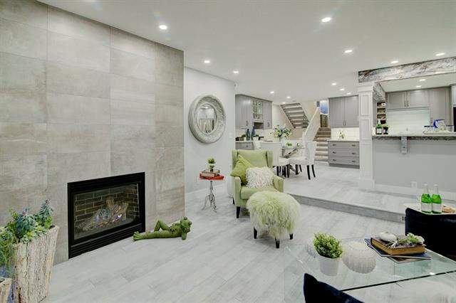 OPEN HOUSE SUNDAY JAN. 27 FROM 2-4 PM. Enjoy the Opulent feel of a new build with this high-end renovation in a beautiful mature community. Do you love the feel of a new home & want the perks of large parks,trees & pathways.Décor,style & Elegance define every inch of this super quiet semi-attached home ( attached only by the garage on either side! ) which has been completely redone. All electrical,plumbing,lighting,appliances,furnace,hot water tank,most windows,paint,flooring,baseboards,fireplace,kitchen,decks & the duradeck covering,sky light & the list continues.With a unique upscale feel this plan allows for cozy quiet week nights in front of the fireplace looking out onto the lovely treed back area.The weekends are brought alive with the large open main floor area to entertain & cook for your guests.Once your guests all head home its up to your Private Master retreat with 20 ft vaulted ceilings & a bath in the Spa like Ensuite.This fabulous home is all about Lifestyle!!