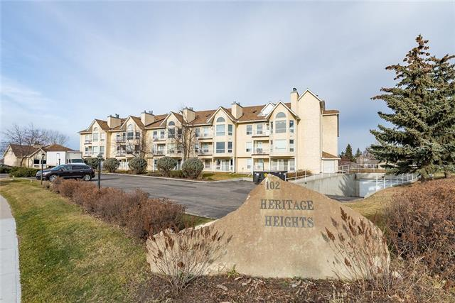 Fabulous location on the main floor, South facing, close to elevator and main door. This great 55+ condo has a lot to offer ie: huge community room with kitchen, a splendid patio/balcony with mountain views and ravine views, under ground heated parkade and walking distance to downtown Okotoks.  This two bedroom unit  has been freshly painted, has laminate flooring in main living area and carpet in bedrooms. Great kitchen with new backsplash tiles. In suite laundry and lots of storage. Bright and airy unit awaiting new owner (s).