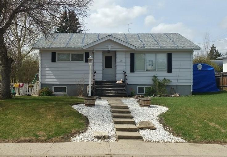 *** PRICE REDUCED***  You will LOVE this 1073 sq. ft. BUNGALOW, nestled on a 60' x 140' fully landscaped and fenced lot, just 2 blocks from Carbon Pre K-9 School.  This 4 bedroom, 2 bathroom home with a HUUUGE Detached Shop/Garage, over 1000 sq.ft. to store both vehicles and an abundance of toys.  Wake up to awe-inspiring coffee or sip a beer on your almost 600 sq.ft. deck!! Think of the family B-B-Q's and hanging around the fire pit on a beautiful summer night.  Situated in a charming and friendly community and only 45 minutes to the Calgary Airport. Ask your favorite realtor for a viewing!