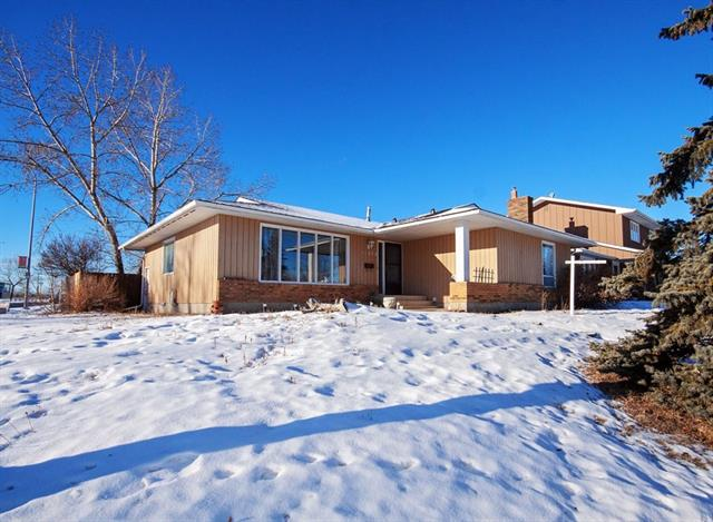**Open House Saturday's 2-4pm** One of the largest bungalows in Lake Bonavista with Mountain Views from the kitchen. This Lake Access and recently refreshed east facing 5 bedroom bungalow offers over 1,600 square feet on a spacious corner lot. Perfect family home with four bedrooms on the main, three full baths and two wood burning fireplaces with both upstairs and downstairs laundry. Private south entrance to the finished basement with large bedroom and tons of storage makes the perfect space for a rec. room for the whole family! This home is a gateway for family fun and recreation with Lake Bonavista privileges; the magnificent Fish Creek Park is right across the street! Fenced yard and double garage backs onto a large school field and is separated by a large paved cul de sac back alley providing additional parking.  Easy access to both Deerfoot  and Macleod Trail,  Ctrain and bus routes (28, 44, 83, 712, 713, 760) nearby. New roof ? 20 year warranty fully transferable.  Move-in ready.