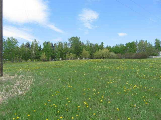 FAMILY COMPOUND???BUILD FOR YOU AND  MOM AND DAD, SISTER AND BROTHER,MOTHER-IN-LAW???,ALL THIS  UNSERVICED LAND FOR DEVELOPMENT AND SEVERAL LOTS ON WEST SIDE THAT CAN BE HOOKED UP TO TOWN SERVICES NOW!Great mountain view ! 8.5 ACRES OF PRIME DEVELOPMENT LAND IN THE MIDDLE OF THE VILLAGE! Reduced to sell! MAKE A FUTURE HERE! It is zoned   R-2 and open to many building opportunities  . The west side is near town services for several lots  and the balance has to be serviced for further development plans. A retirement villa complex??? Modular affordable housing? Bring your ideas here ,the council is cooperative to work with you to expand their village for a residential build--25 minutes from the high prices in Cochrane ! Call to discuss what has been done to date!Owner will consider offers and/or a trade for value.