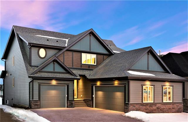 Quite possibly the most stunning panoramic lake view in all of Calgary!  Enjoy amazing sunsets & access to lake recreation year round from your private dock. This SAM award nominated home built by Morrison is still covered under Alberta New Home Structural Insurance Warranty until 2024  Entertaining & relaxation are easy, from any of the 3 well equipped patios - including a lakeside entertainment area and an all-season screened in patio with built in patio heaters and a hot tub. Over 4000 sq ft of developed space  this home is perfect for a family of any size.  The stunning kitchen is equipped with Huntwood cabinetry, a massive island, and the highest end appliance package ever seen in Auburn Bay - featuring 4 Miele wallovens (including Steam and warming oven),Miele built-in gourmet coffee system, Miele induction cooking (with rough-in for gas ) 2 Miele dishwashers,3 Subzero refrigerators.  Upgraded insulation, triple pane windows ,Led lighting throughout, York high efficiency heating & cooling . 10/10