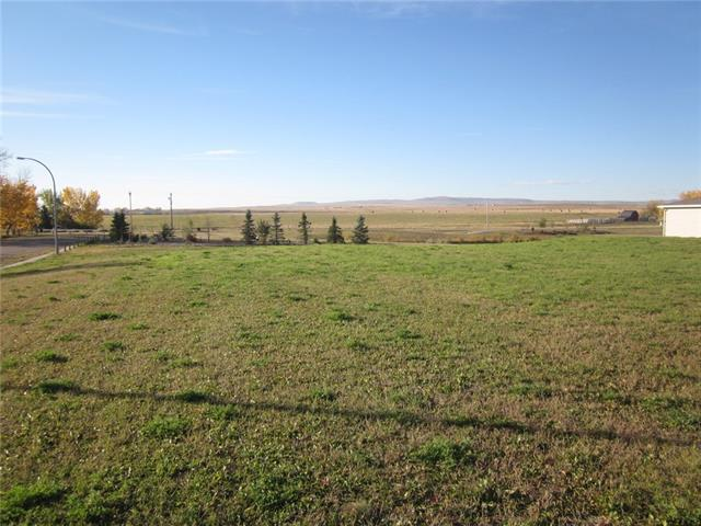 Attention Developers, Contractors or Investors.  Presenting a 156' x 196' lot zoned Direct Control in the Town of Nanton.  Options galore with quality location, close to walking paths, pond, trees and open views to the South.  Corner lot with access off both Westview Drive and 27th Avenue.  Purchase now to build or hold onto this investment and build in the future.  DC1 - Direct Control zoning requires council approval for all development on land.