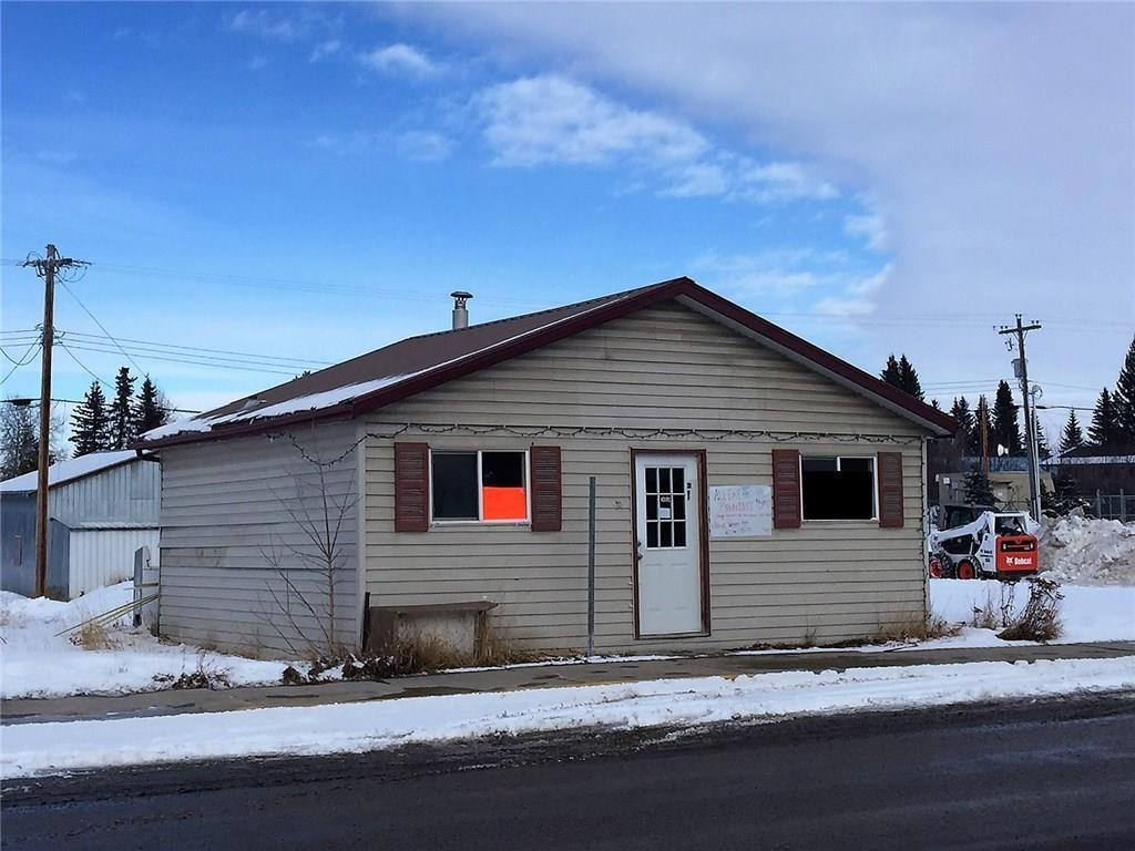 OPPORTUNITY KNOCKS!  An affordable opportunity to start your own business with great exposure!  Highway 22 & 54 Main street frontage in Caroline Alberta.  50 x 120 ft lot with a cozy 2 room storefront and bathroom!  Ideal for office or service based business!  The seller is a licensed Realtor in the province of Alberta