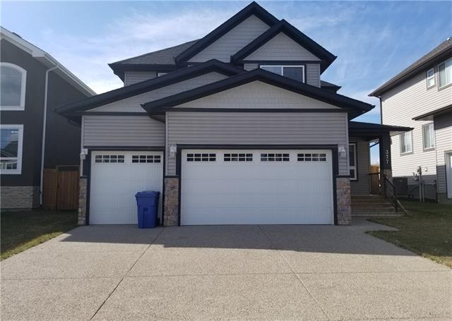 Within walking distance to Chestermere's Newest School, this home offers something for everyone in the family! From the triple car garage, to the Granite counters in the kitchen, to the three large bedrooms and bonus room! Move in ready, this property features an open floor plan! Large entrance with easy care flooring, gleaming hardwood throughout the main floor. Stainless steel appliances in the sun drenched kitchen, walk thru pantry, main floor laundry with sink, spacious great room with a cozy gas fireplace, and a two piece powder room. The upper level has three good sized bedrooms and a bonus room. The master has a separate tub, oversized shower and walk in closet. The basement is unfinished, ready to complete according to your own requirements. A great property in a family friendly community! Call to book your appointment!