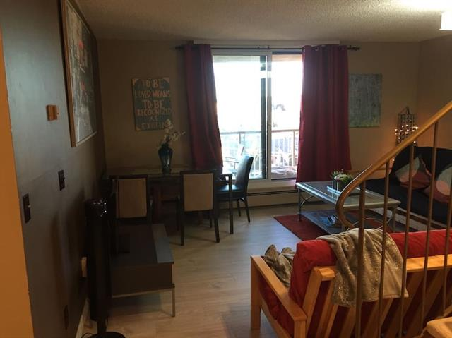 Sub-penthouse has entrances on both 9th & 10th floor adding to the privacy and comfort.In a lighter vein neighbors don't know if you are in or out. Independent two entrances makes it complete unit on each floor gives options about subletting. Sub penthouse has a huge master bedroom remodeled from original 2-bedrooms. It has two storage rooms & its 1.5 washroom is a rare find in the building. Mountain views on west extend to SW to COP. It comes with a covered parking, new flooring, new vanities, new stove and refrigerator. Building offers newly renovated indoor swimming pool, fitness room, two exclusive tennis courts, social room and business center with WiFi. It's walking distance to Dalhousie LRT station and bus terminal and short walk to Walmart, Canadian Tire, Chapters, and Safeway. It is close to University of Calgary, Foothills Hospital, SAIT and shopping malls. In addition, strategic location of security cameras in and out of building makes it a value buy for safe and healthier living  in Calgary.