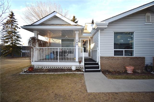 Two bedroom end unit!+50 community of Heritage Villas. Perfect lock and leave for snowbirds or a light and bright home for those long Calgary winters. Main floor features generous sized master bedroom w/ 3 pc ensute and 2 closets, nice sized 2nd bedroom w/ large window out to back deck, formal dining area and main floor laundry off the main 4 pc bathroom. Good sized living room and kitchen w/ eating area and 2 pantries complete the main floor. Good sized covered front patio and open rear deck with recent flooring replacements and updated railings provide excellent outside living space. Basement fully developed w/ a newer 4 pc bathroom, 2 storage rooms, closet, office nook and bright wide open room excellent for crafting or quilting. Updated heating system w/ high efficiency furnace. Shingles replaced in whole complex (approx. 4 yrs ago). Clubhouse has library, games, meeting room, kitchen. Community has active social club with ongoing social events. Well managed and maintained.