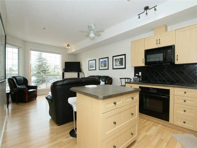 TWO BEDROOM - TWO BATHROOMS - TWO TITLED HEATED PARKING STALLS - TWO STORAGE. Riverfront pathway location in the community of Parkdale. Maple kitchen cabinets, black appliances with center island. Open concept spacious living room with corner gas fireplace and large windows. Patio doors onto private covered outdoor balcony with BBQ gas hook ups. 9 ft ceilings and separate in floor heat controls. Master bedroom includes 4pc en suite bathroom with jetted tub & separate shower. In suite laundry and storage. Two Titled, heated underground Parking stalls with Two storage lockers. Steps to the river path, close to downtown, U of C. Shows well! Please see full Virtual Tour.