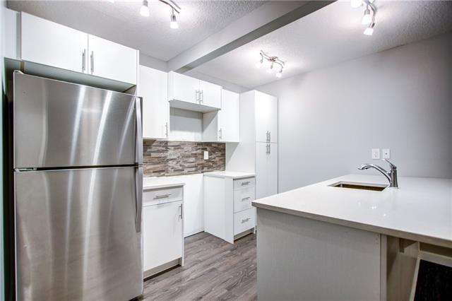 A FULLY RENOVATED home located PuraVIDA on a quiet street walking distance to the shops and restaurants of Marda Loop. Inside the home boasts a bright and open living space with laminate floors, modern cabinetry and finishes, eating bar, and quartz countertops. Complete with walk-in closet, 4-piece bath, laundry, parking and more. Low condo fees include heat and water. Amazing South Calgary location walking distance to Marda Loop, transit, community centres, shops, restaurants, and a short drive downtown!