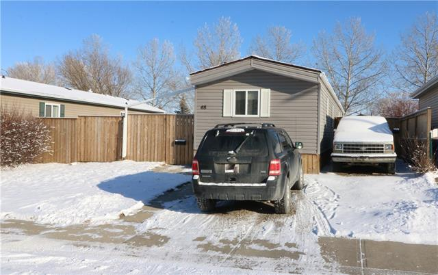 Here?s an affordable Airdrie opportunity. A fully fenced yard, which is over 475 sq. m2, offers room for the family/pets, with a place to park your RV, boat or toys. The location offers easy access in & out of the area & is close to schools, shopping, Genesis Place, pathways, parks & ponds that are used frequently by the public. The improved manufactured home is on its own lot, No lot/pad fees. Some of the improvements include furnace, H2O heater, PVC framed windows, doors, laminate & tile flooring, some lighting fixtures/switches, soaker tub, low-flush toilet, asphalt shingles, eves-trough vinyl siding, larger deck 12.4?X30?, 2 storages sheds 8?x12? & 8?x10? etc. Move in & enjoy. Build your equity & advance when you are ready? Stop Renting? Why not OWN your home & land?