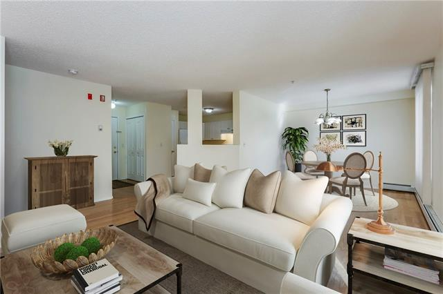 NEW PRICE ADJUSTMENT FOR THE MARKET! This unique apartment is 2 stories of bright warm space in a 45+ building. At almost 1400 square feet it lives more like a town house than a traditional apartment! The main floor is open plan with the large kitchen looking out to the dining and living areas, which open to a lovely patio.  A two piece bath and some storage complete the first level.  Upstairs you will find the large master which has its own private balcony and 3 piece ensuite. A second bedroom, oversized laundry and a 4 piece bath complete the second level.  The building is in a great location, a block from the C Train and walking distance to shopping, pubs, restaurants and Fish Creek Park.  The unit includes 1 titled indoor heated parking spot and 1 separate indoor heated storage space.  These two story units are very rare - come and see for yourself!