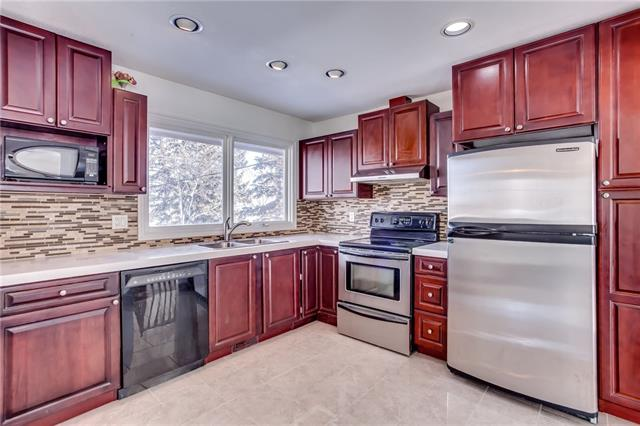 This stunning renovated bi-level home features OVER 2200 sqft of developed living space and is just minutes from Fish Creek Park, schools and shopping! Upon entering the home you will be greeted by sunlight. The main level, open concept layout is modern and completely updated (even has a fresh coat of paint). It features granite and porcelain floor tiles, high end laminate, custom curved concrete counter tops in the nook and kitchen. The kitchen has gorgeous Cherry wood ceiling height cabinets, stainless steel appliances and breakfast bar. The large master bedroom features an ensuite with beautiful views of your private well landscaped yard. The other two upstairs bedrooms are a great size and share a hallway bathroom that has been recently renovated and includes custom tiling and soaker tub. Downstairs you?ll find one additional large bedroom and another oversized office/bedroom. The family room is great for cozying up to the wood burning fireplace that features custom tiles imported from Germany.