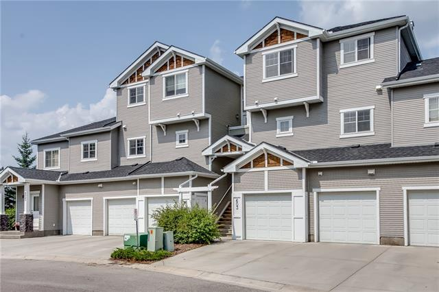 Excellent value in this well maintained, two storey townhome in the great community of Cougar Ridge, close to shopping, restaurants, the mountains, park and walk to schools. The kitchen is open, bright and spacious with lots of counter space, cabinets, a breakfast bar, walk-in pantry, and overlooks the lovely dining and living rooms.  There is also a two piece bath and a good size laundry room on this level.  Upstairs are three good size bedrooms, with the master having a walk-through closet, which leads into the main (four piece) bath.  Off the living room is a large balcony with great views of the lovely park across the street, as well as views of the ski hill and surrounding areas.  The single attached garage is spacious, and has a driveway which can accommodate a second car.  Great value here and easy to show....don't miss out!!!