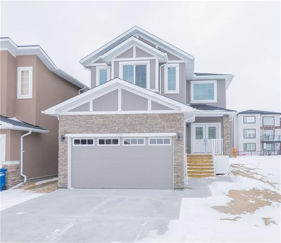 BEAUTY AWAITS! Welcome to 232 Baysprings Gardens! This home is set to WOW you the second you step in. Walk in to the GRAND open to above FOYER feeling welcomed. The main floor of this home has a MASSIVE and bright living room with a Gas Fireplace, a dinning nook, a very functional kitchen with S/S appliances and QUARTZ counter tops, a pantry, a FORMAL Dinning area, a DEN and a 2 pc powder room. Upstairs are 3 Bedrooms and 2 FULL Bathrooms which includes the Master Bedroom and 5 pc ENSUITE. The HUGE Vaulted Ceiling BONUS ROOM and Laundry room completes this floor. The basement is bright with huge windows and waiting for your touch. Exterior is Stuccoed and Brick. See this one before it's gone!
